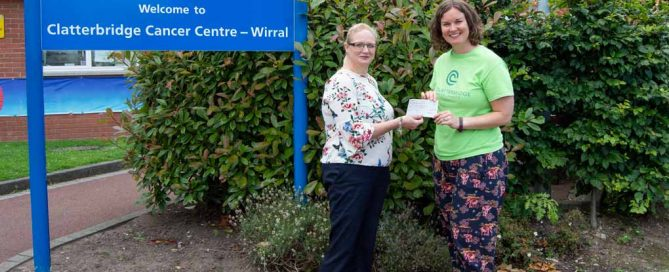 Alisha Butler of Phoenix Solicitors presents a cheque to The Clatterbridge Cancer Charity